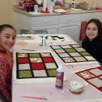Girls making quilts