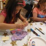 Girls designing doll T-shirts