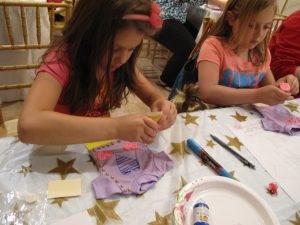 Girls designing doll T-shirts