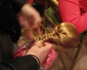 Girl working on doll hair
