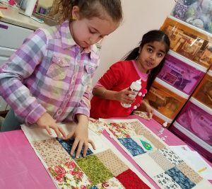Girls create Addy's Quilt at Girl AGain by Julia M.