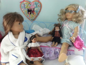 Dolls chatting in bed
