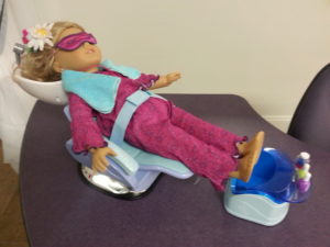 Doll in spa chair