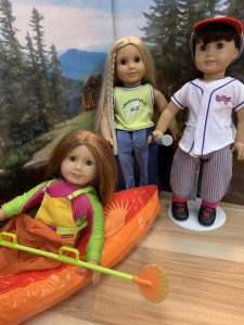 American Girl dolls in sports outfits