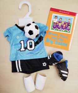 soccer outfit and book